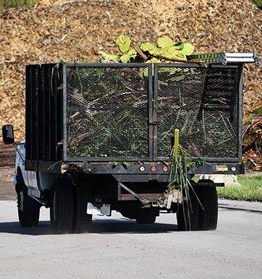 yard waste truck, drop off road, yard debris in truck, customers of 1 stop
