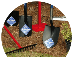 landscaping tools, shovels, rakes, wolverine tools on mulch